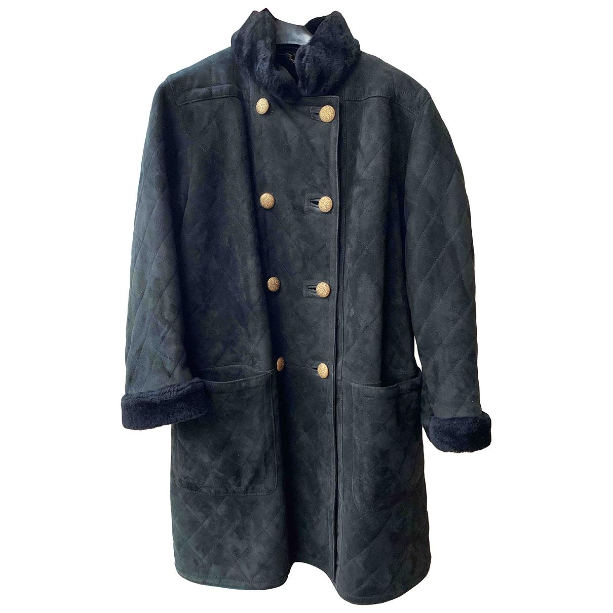 Saint Laurent - Manteau   pour femme en cuir - noir