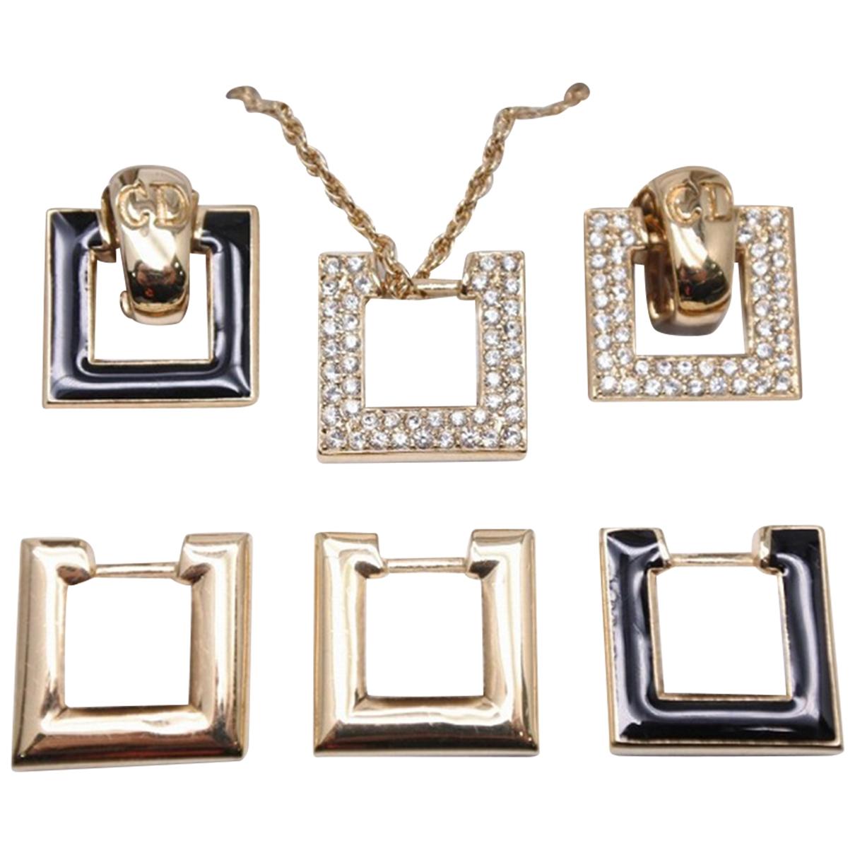 Dior - Parure   pour femme en metal - dore