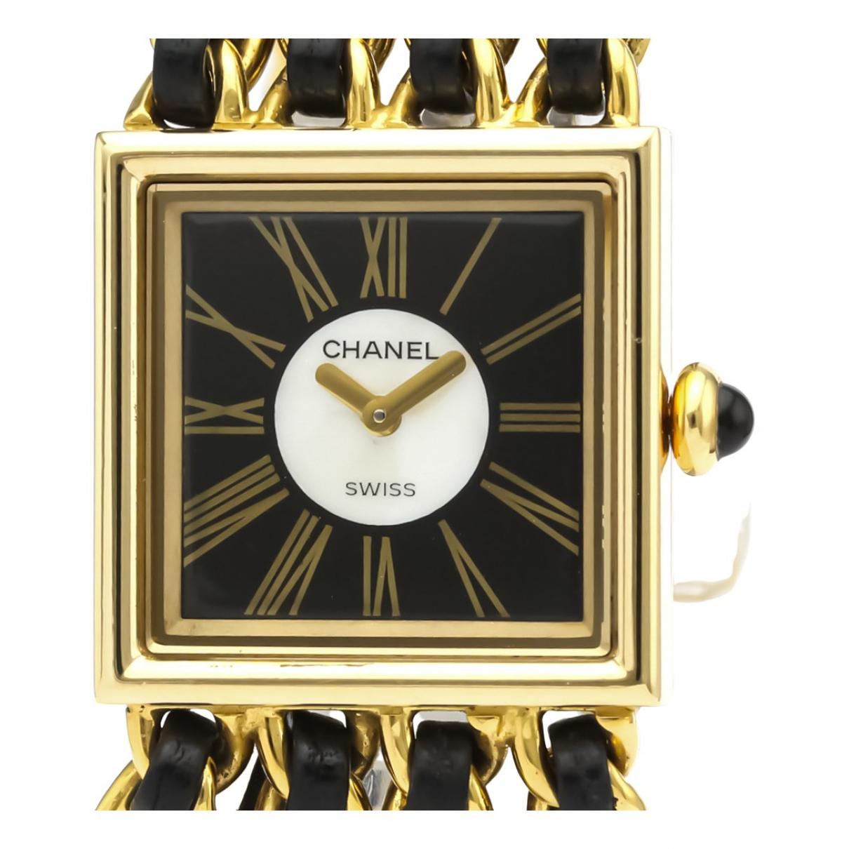 Chanel - Montre   pour femme en or jaune - noir