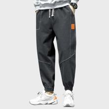Men Letter Patched Drawstring Waist Jogger Jeans