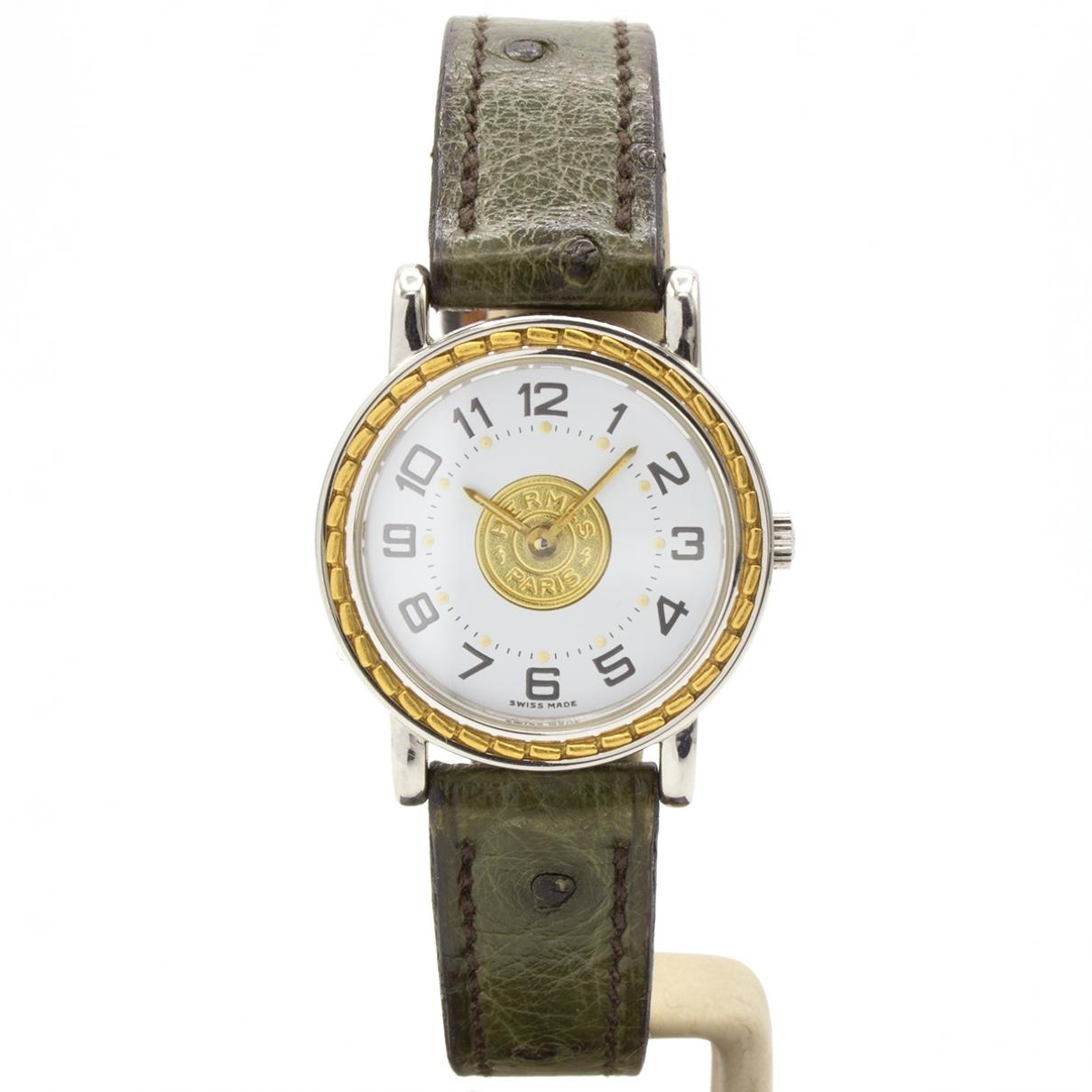 Hermes Sellier Uhr in  Gold Gold und Stahl