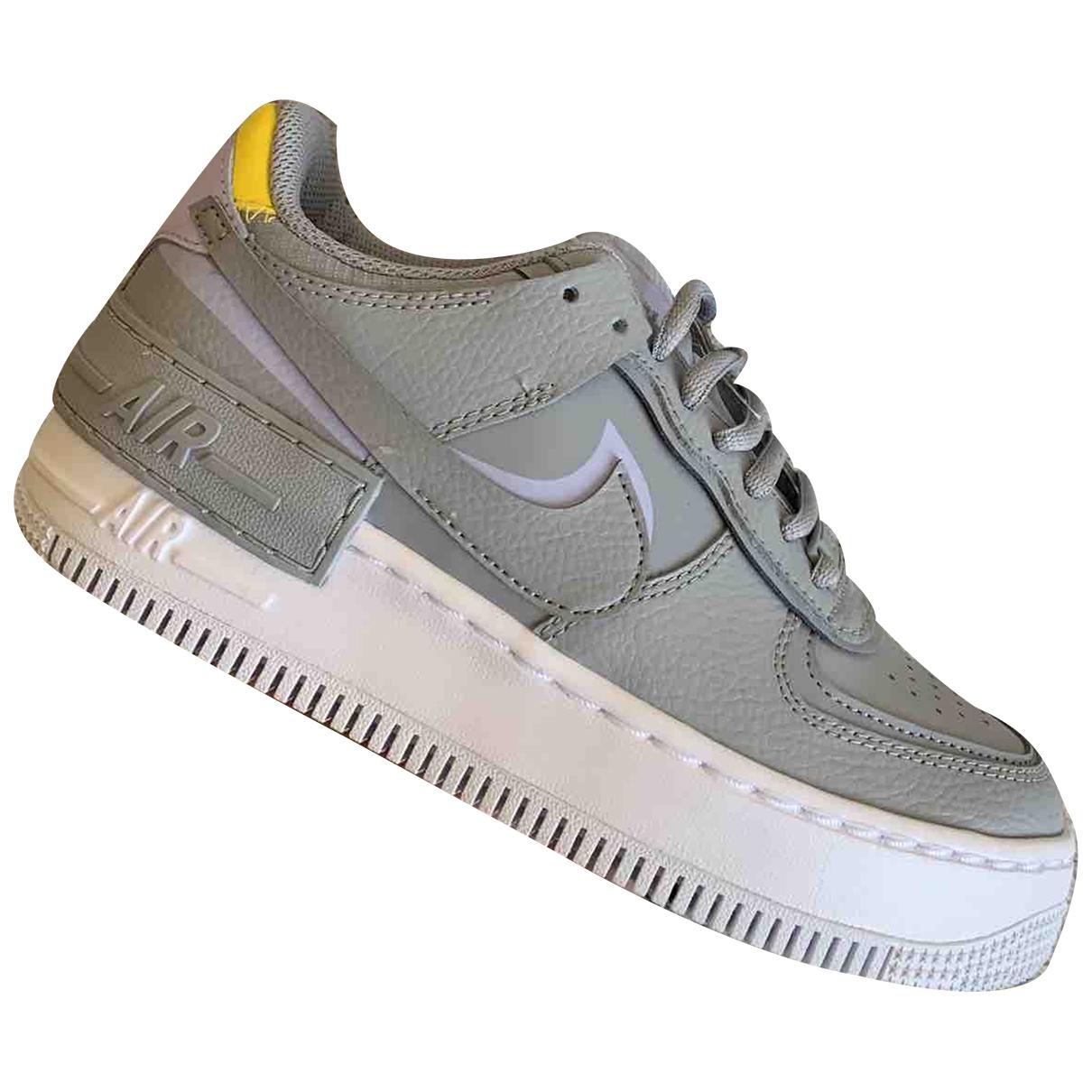 Nike - Baskets Air Force 1 pour femme en cuir - gris