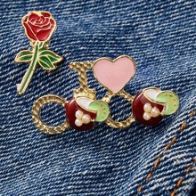 2 piezas broche con patron de rosa y corazon