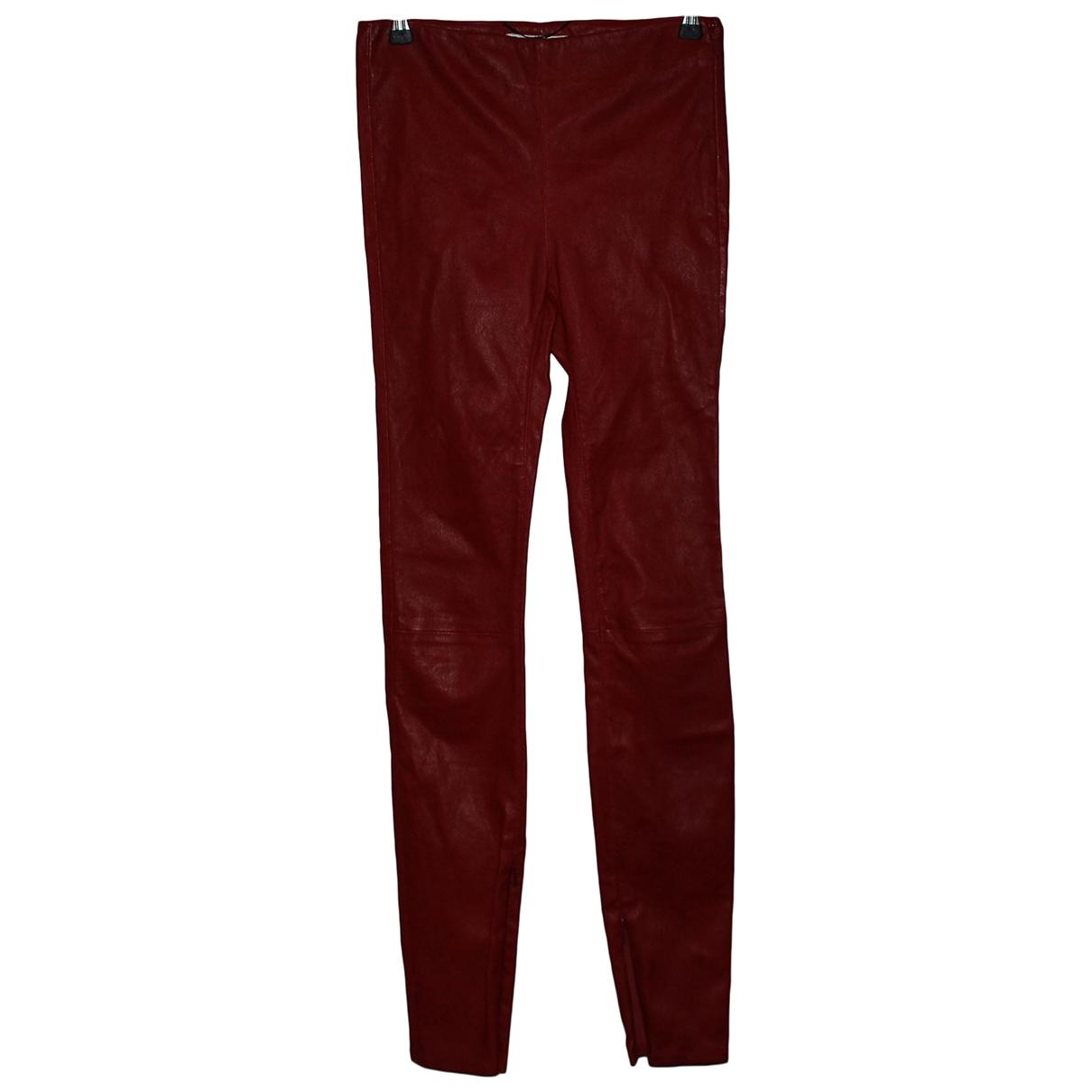 Saint Laurent - Pantalon   pour femme en cuir - rouge