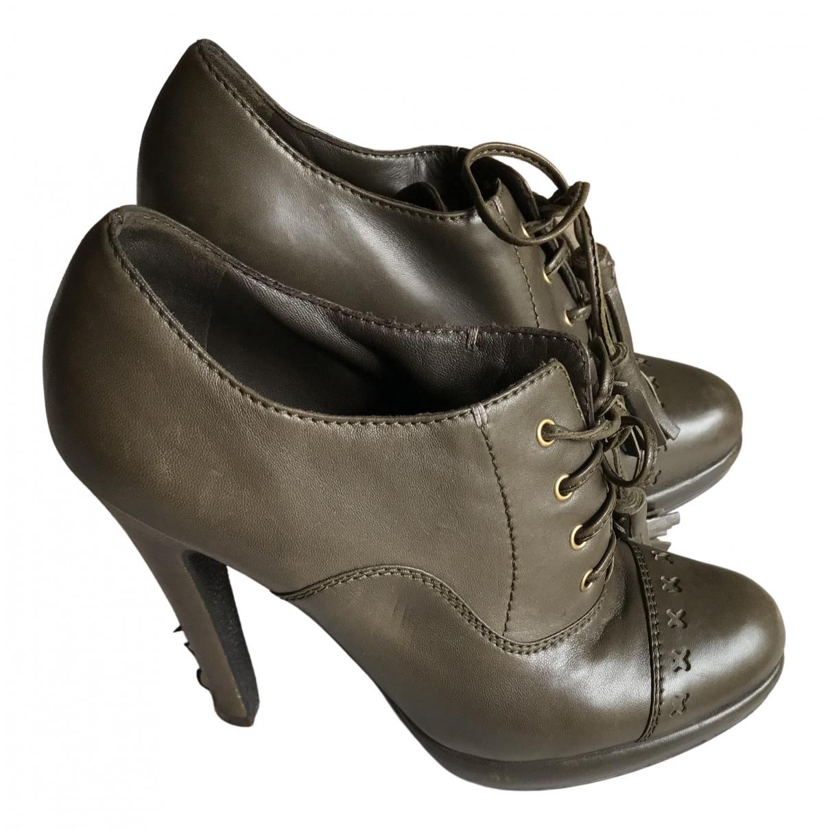 Yves Saint Laurent - Boots   pour femme en cuir - kaki