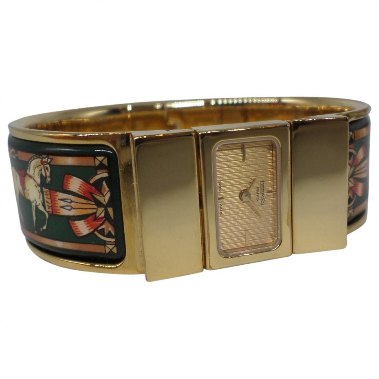Hermes - Montre Loquet pour femme en plaque or - dore