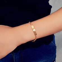 Armband mit Geo Dekor und metallischem Detail