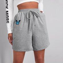 Shorts con estampado de mariposa de cintura elastica con nudo