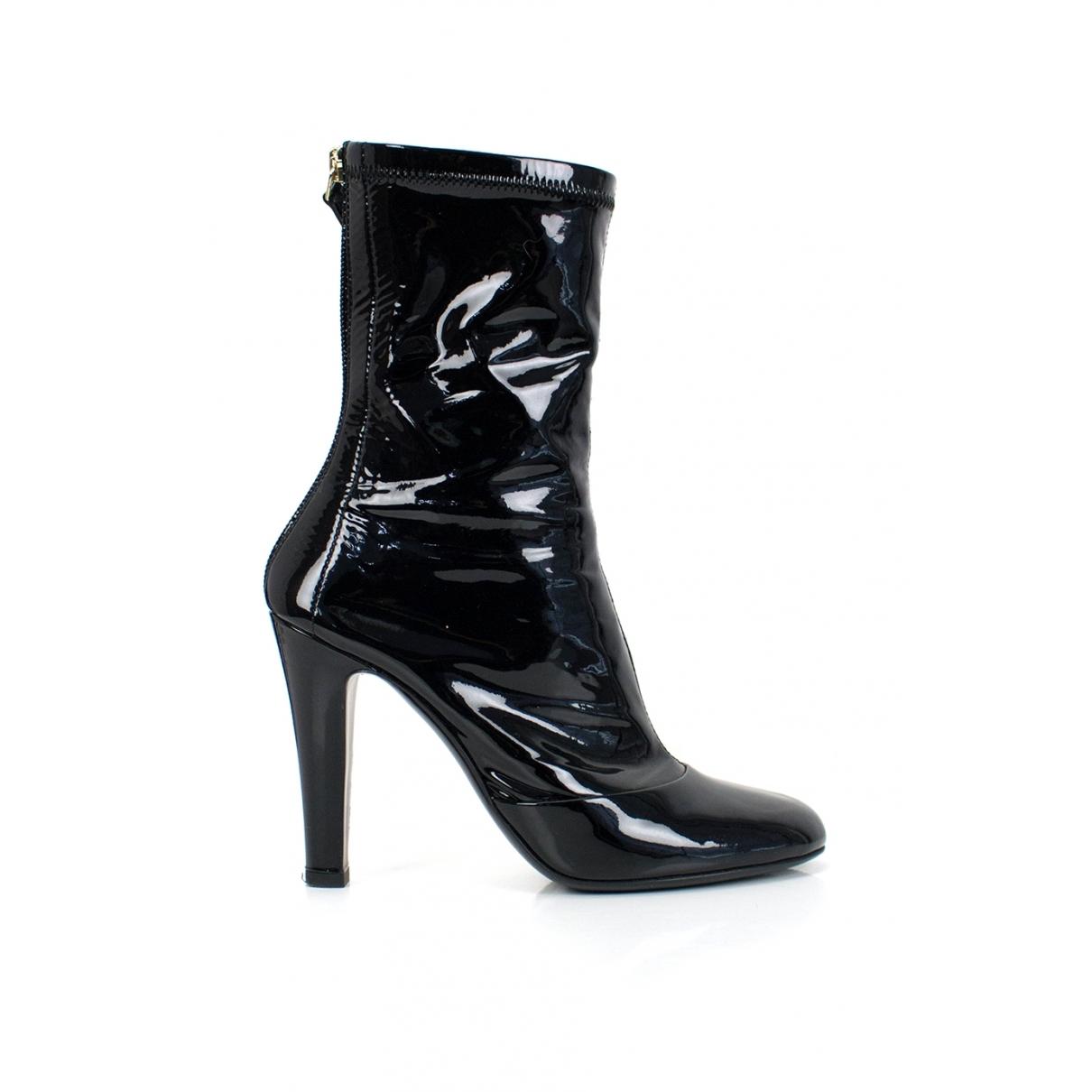 Chanel - Bottes   pour femme en cuir verni - noir