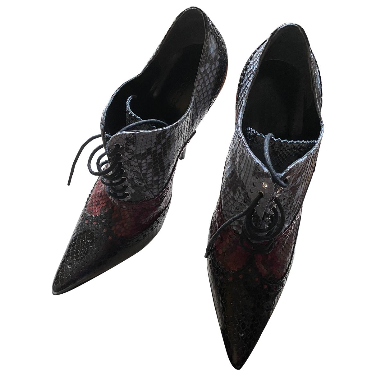 Botas con cordones de Piton Gucci