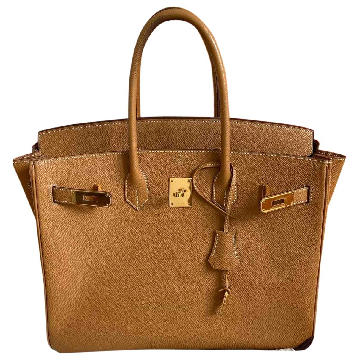 Hermes - Sac a main Birkin 35 pour femme en cuir - dore
