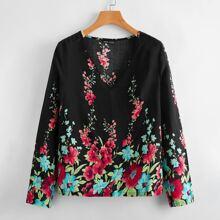 Bluse mit Blumen Muster und V-Kragen