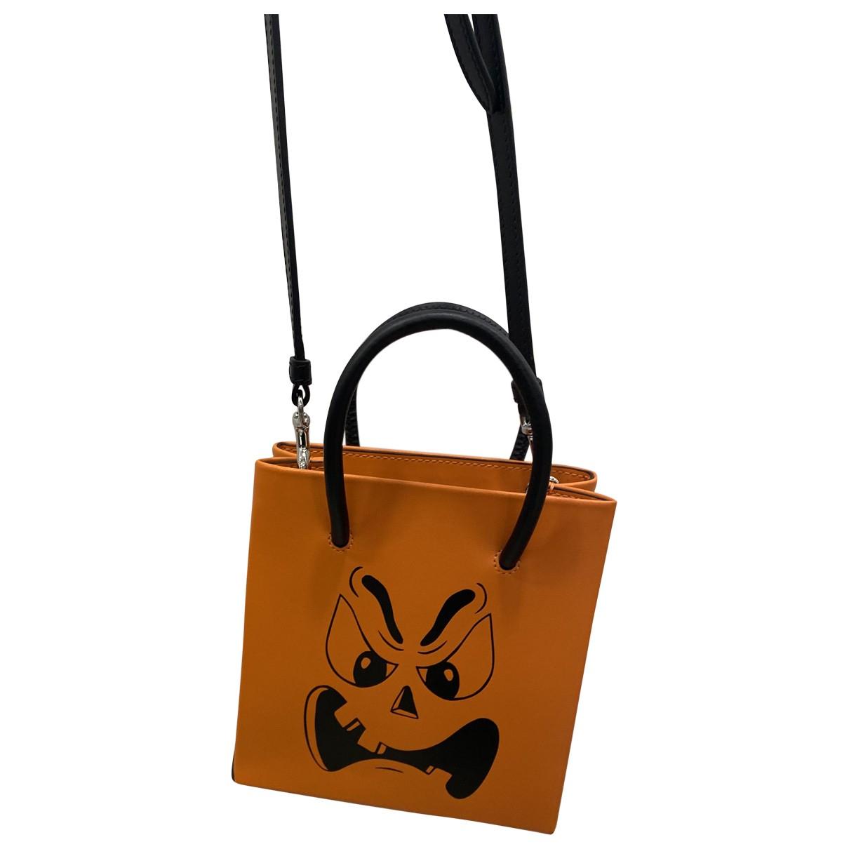 Moschino \N Clutch in  Orange Leder