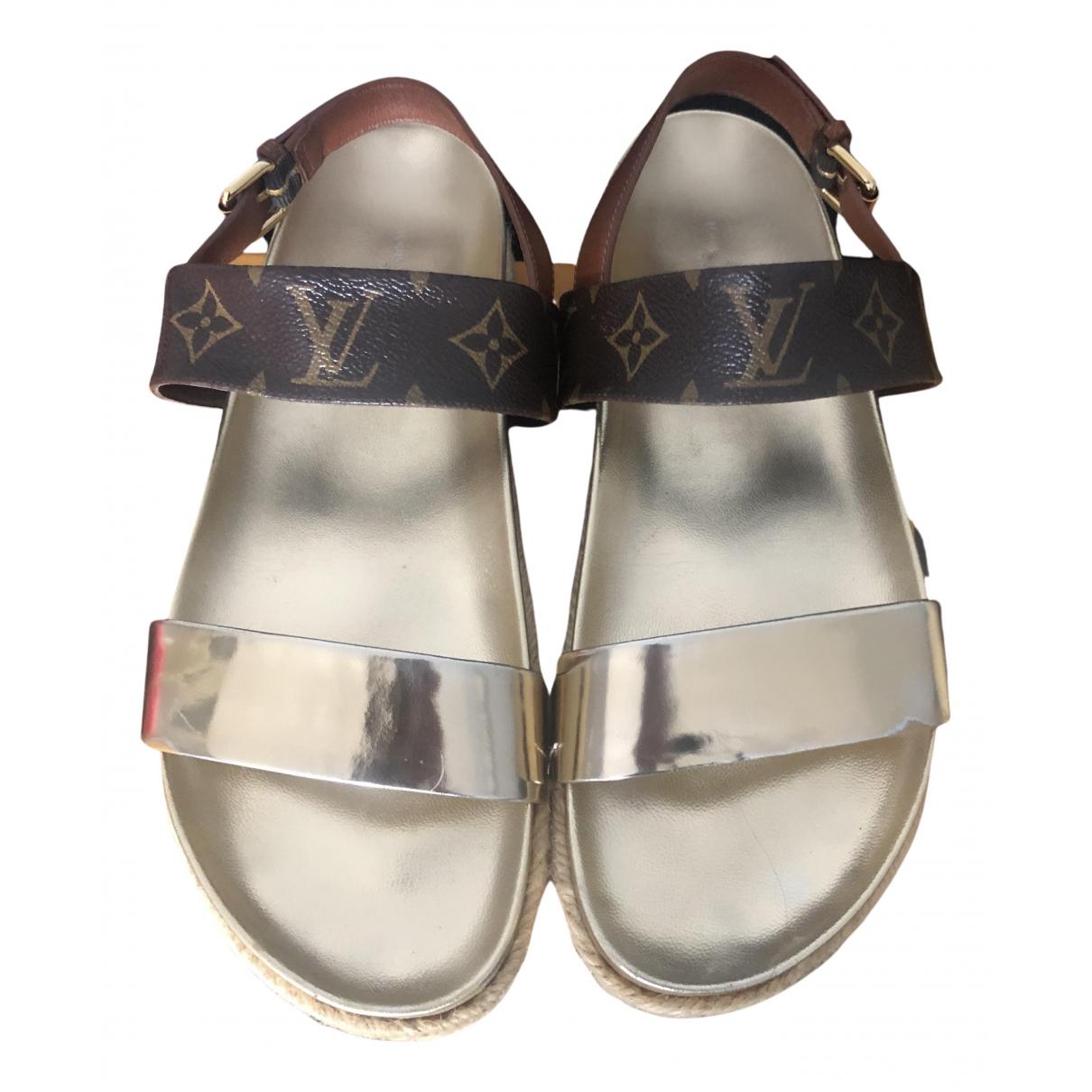 Louis Vuitton - Sandales   pour femme en toile - marron