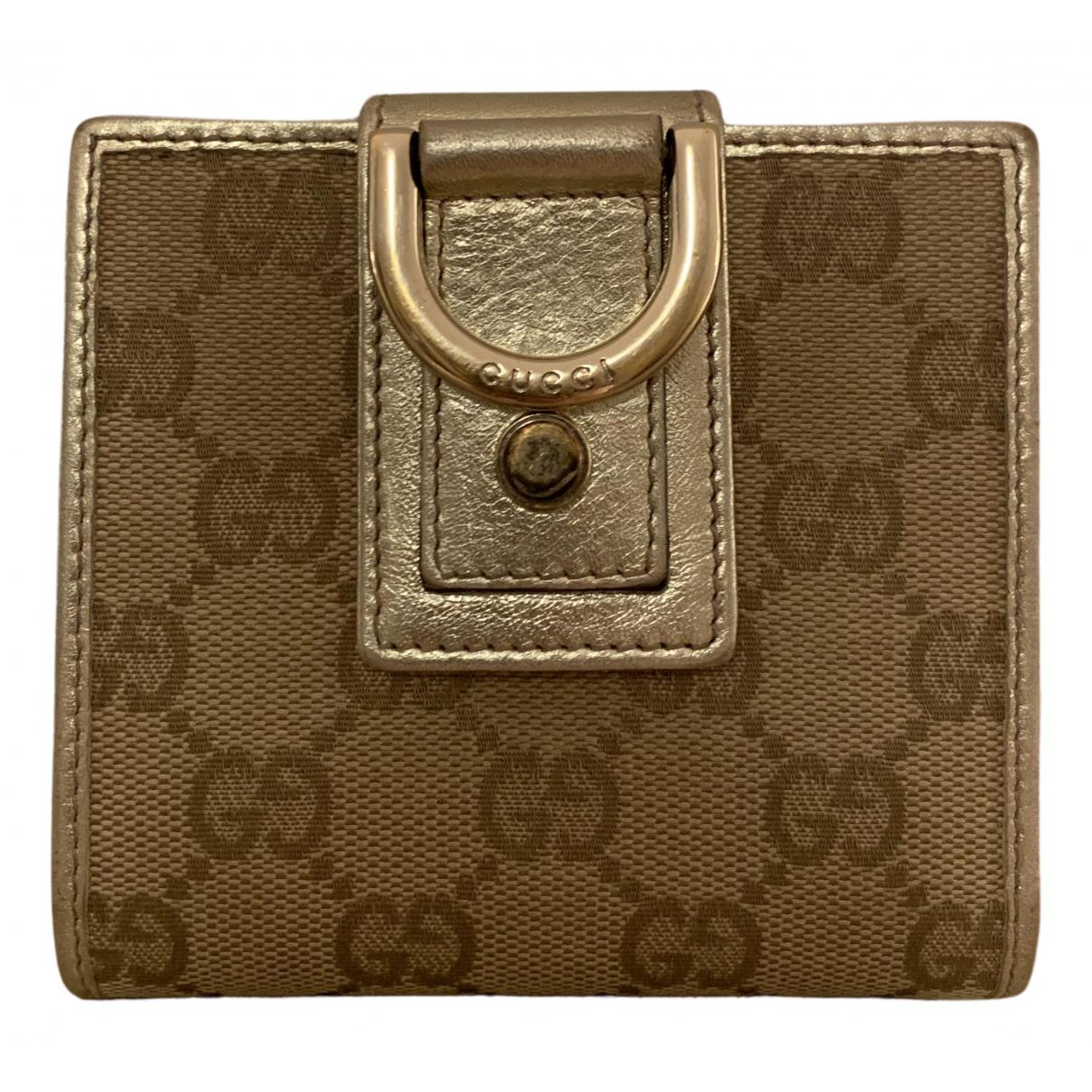 Gucci Ophidia Portemonnaie in  Gold Leinen