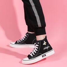 Segeltuch Schuhe mit Schmetterling Stickereien und Band vorn