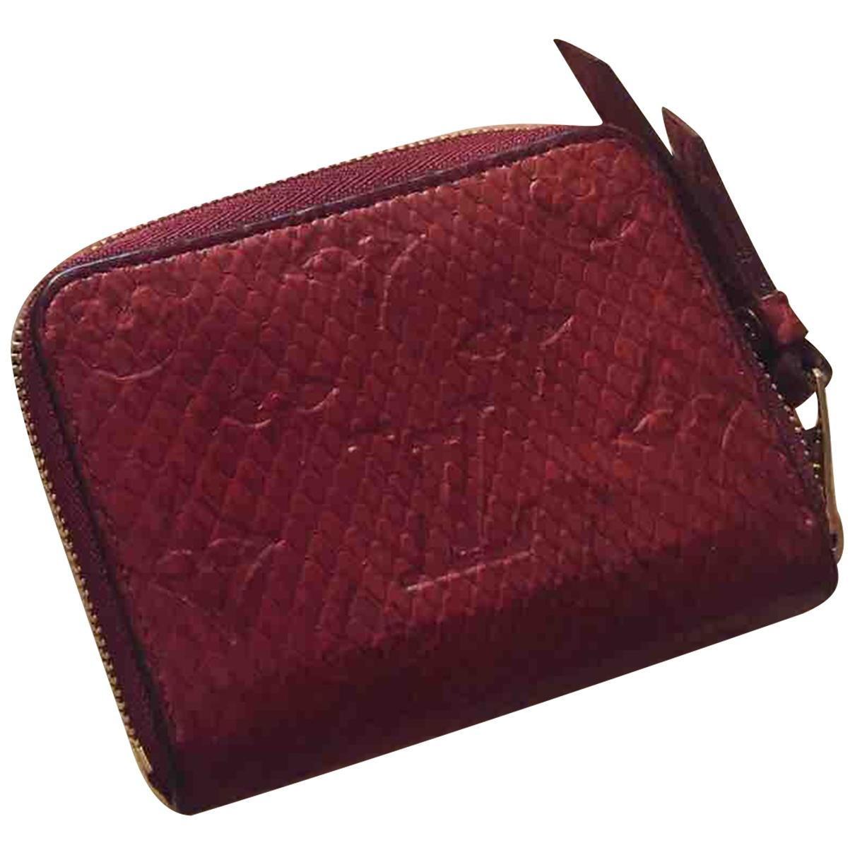 Louis Vuitton - Petite maroquinerie Zippy pour femme en python - rouge