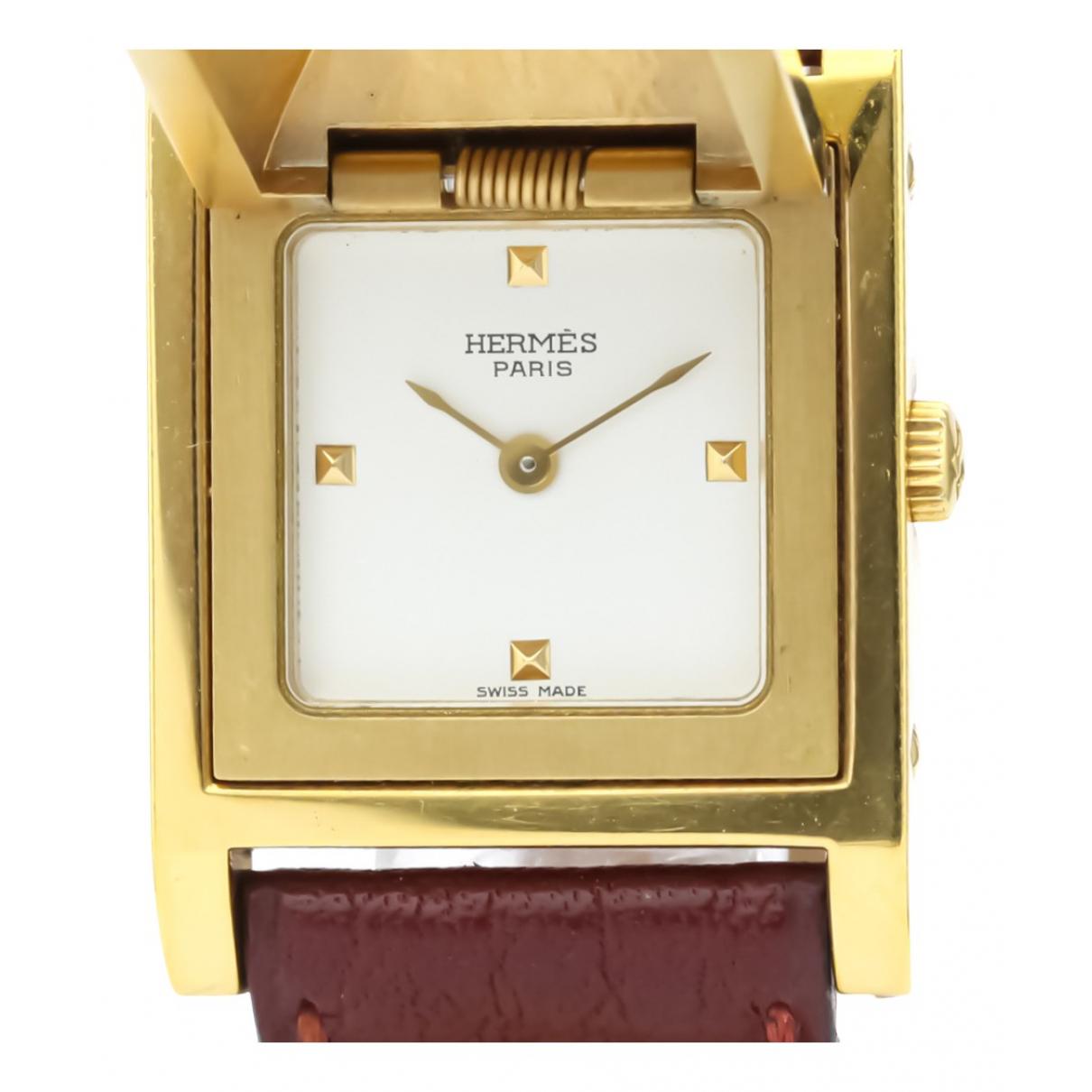 Hermes - Montre Medor pour femme en plaque or - blanc