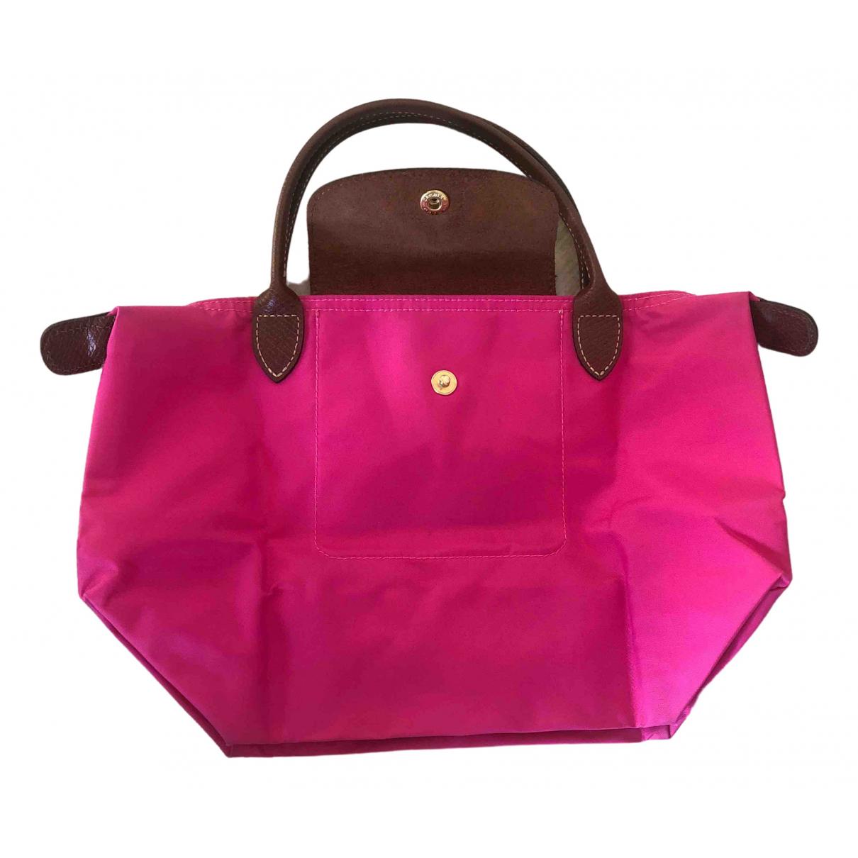 Longchamp Pliage  Pink Cloth handbag for Women \N