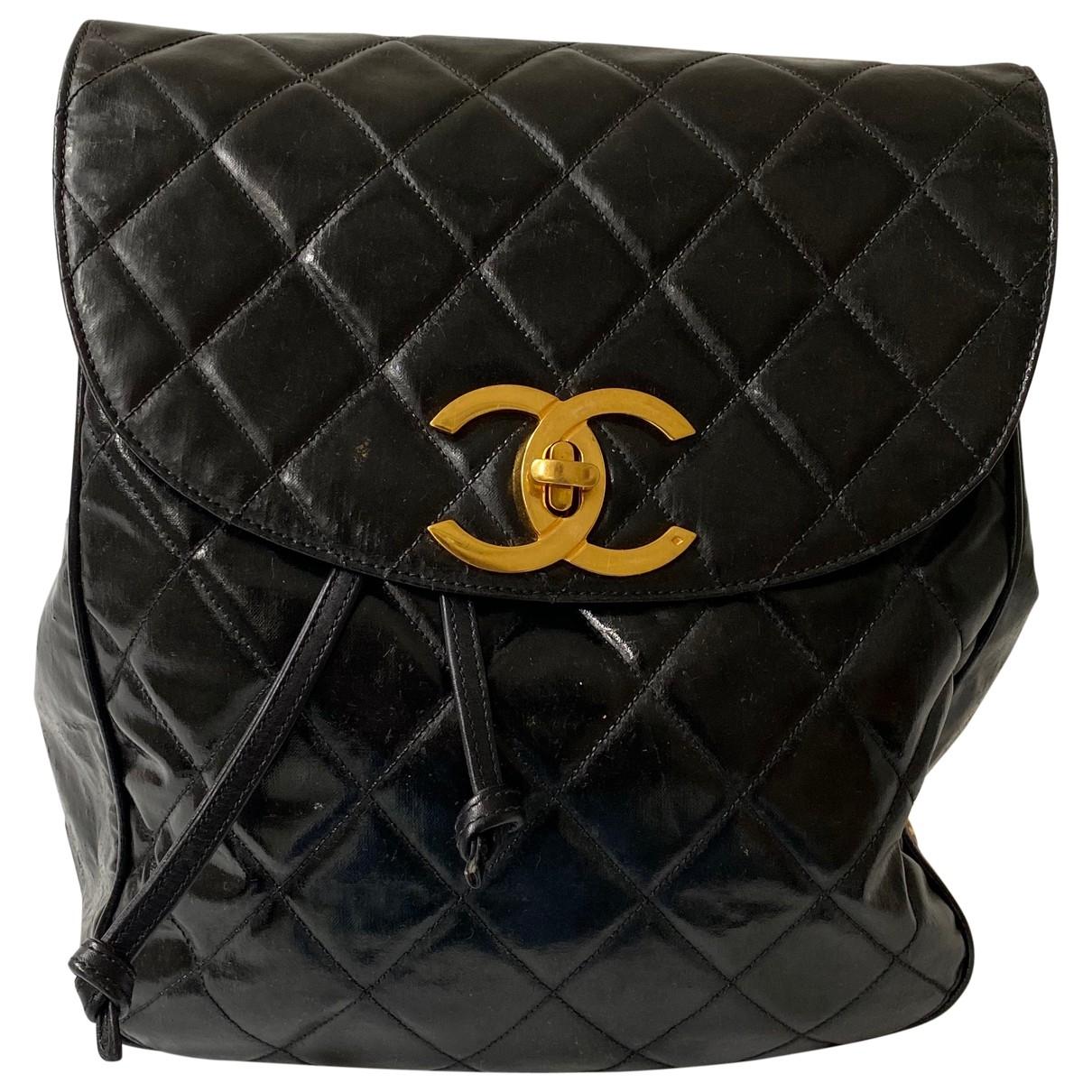 Chanel - Sac a dos   pour femme en cuir verni - noir