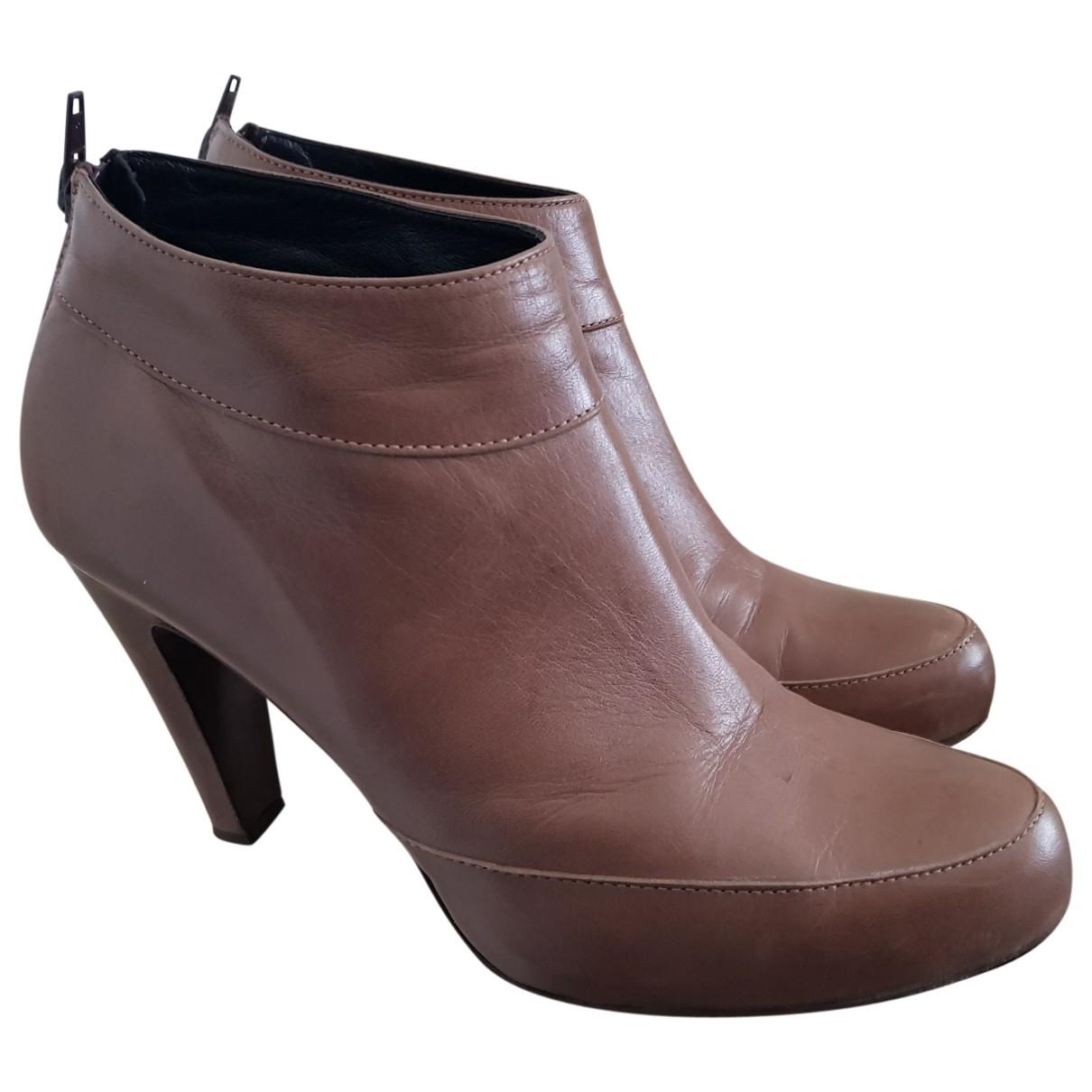 - Boots   pour femme en cuir - beige