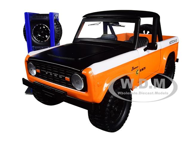1973 Ford Bronco Metallic Orange and Matt Black KC HiLiTES with Extra Wheels Just Trucks Series 1/24 Diecast Model Car by Jada