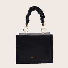 Bolsa cartera con estampado de letra
