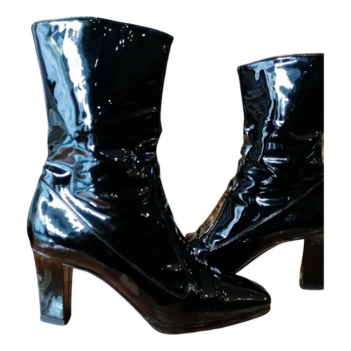Yves Saint Laurent - Boots   pour femme en cuir verni - noir