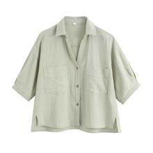 Camisa bajo con abertura con doble bolsillo