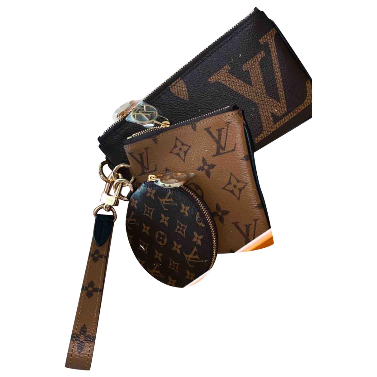 Louis Vuitton Trio pouch Clutch in  Braun Leinen