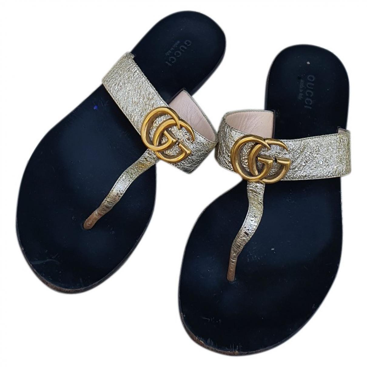 Gucci - Sandales Double G pour femme en cuir - dore