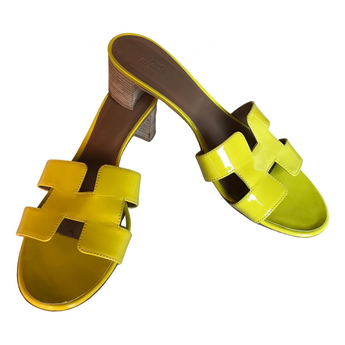 Hermes - Sandales   pour femme en cuir verni - jaune