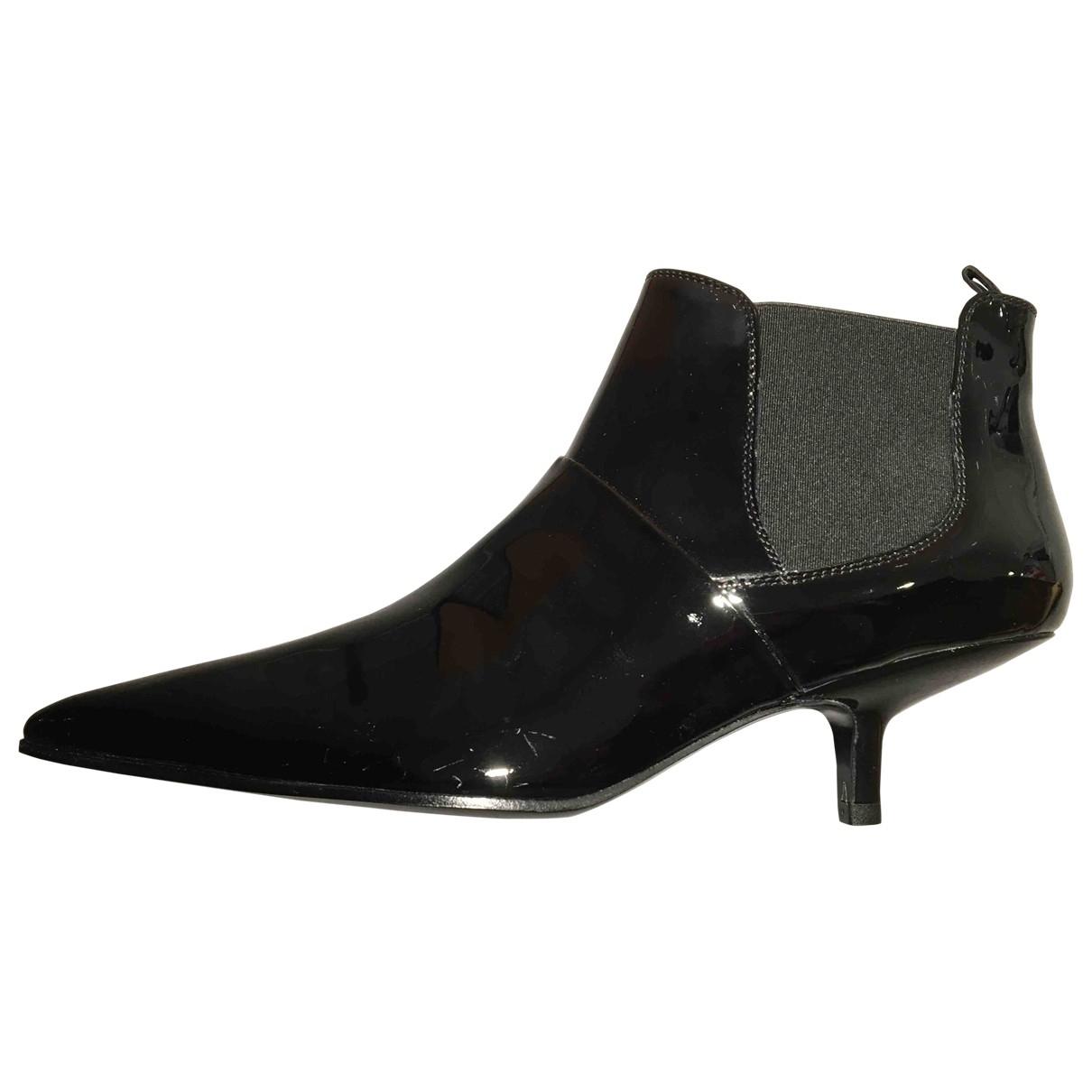 Acne Studios - Boots   pour femme en cuir verni - noir