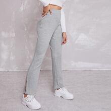 Pantalones tejidos de canale bajo con abertura