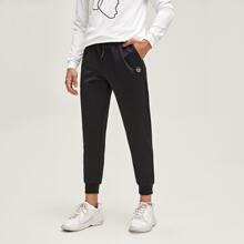 Pantalones con bolsillo delantero con parche