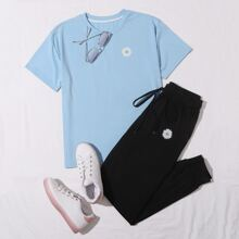 Camiseta floral de margarita con joggers con cordon