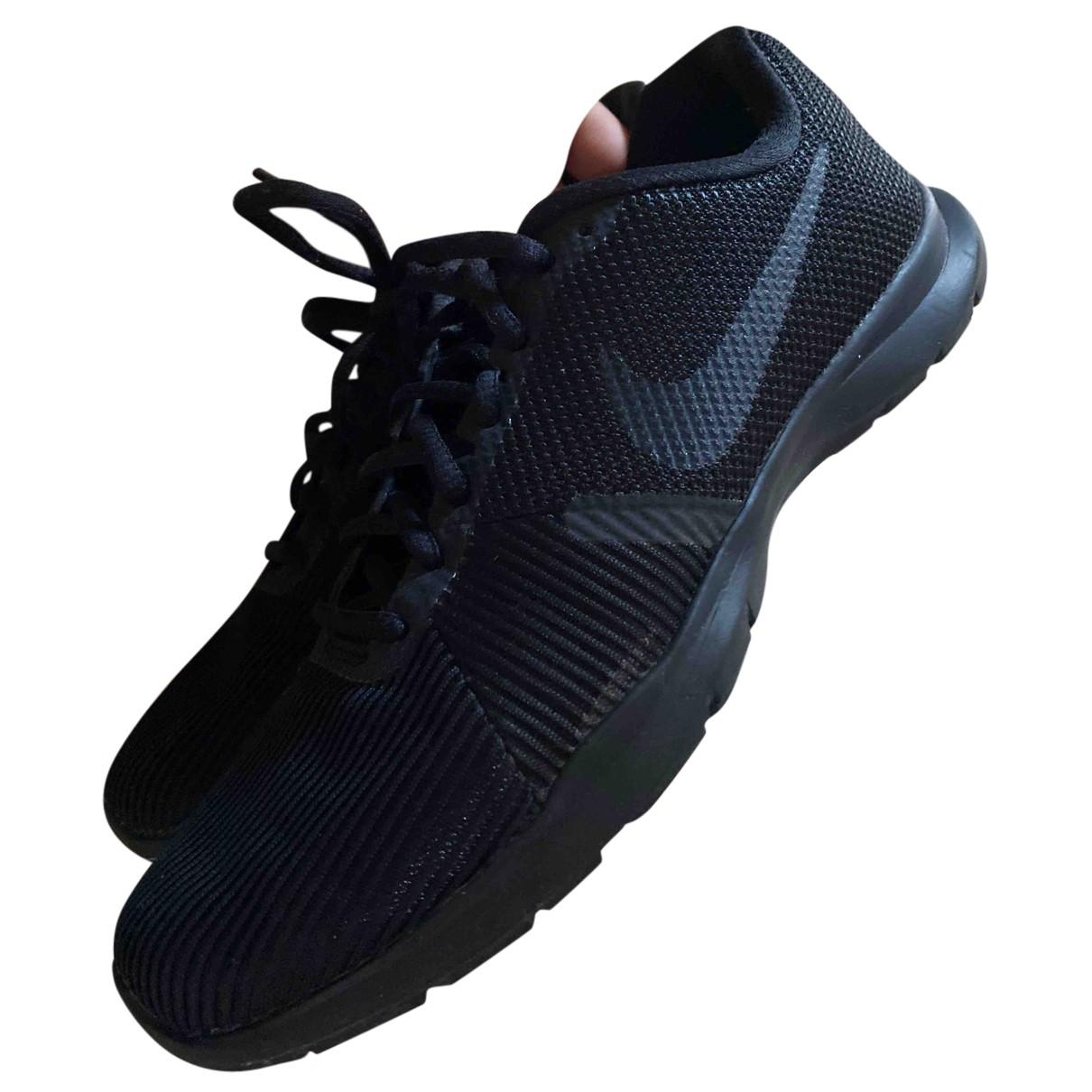 Nike - Baskets Flyknit Racer pour femme en toile - noir