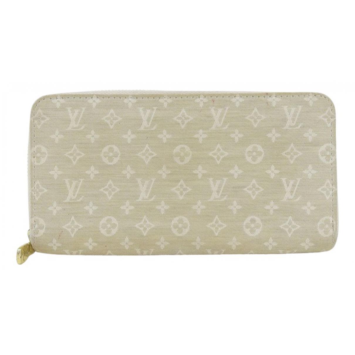 Louis Vuitton - Portefeuille Zippy pour femme en toile - beige