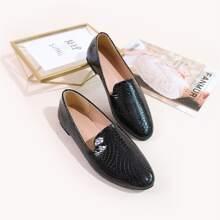 Zapatillas con diseño de cocodrilo
