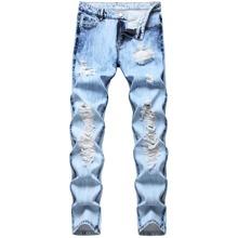 Schmale Jeans mit Riss und Waesche