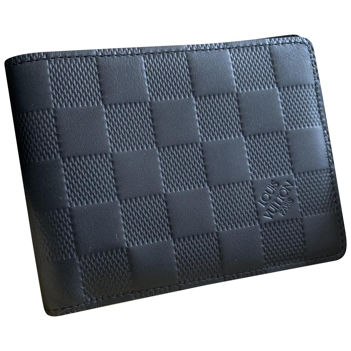 Louis Vuitton - Petite maroquinerie Marco pour homme en cuir - noir