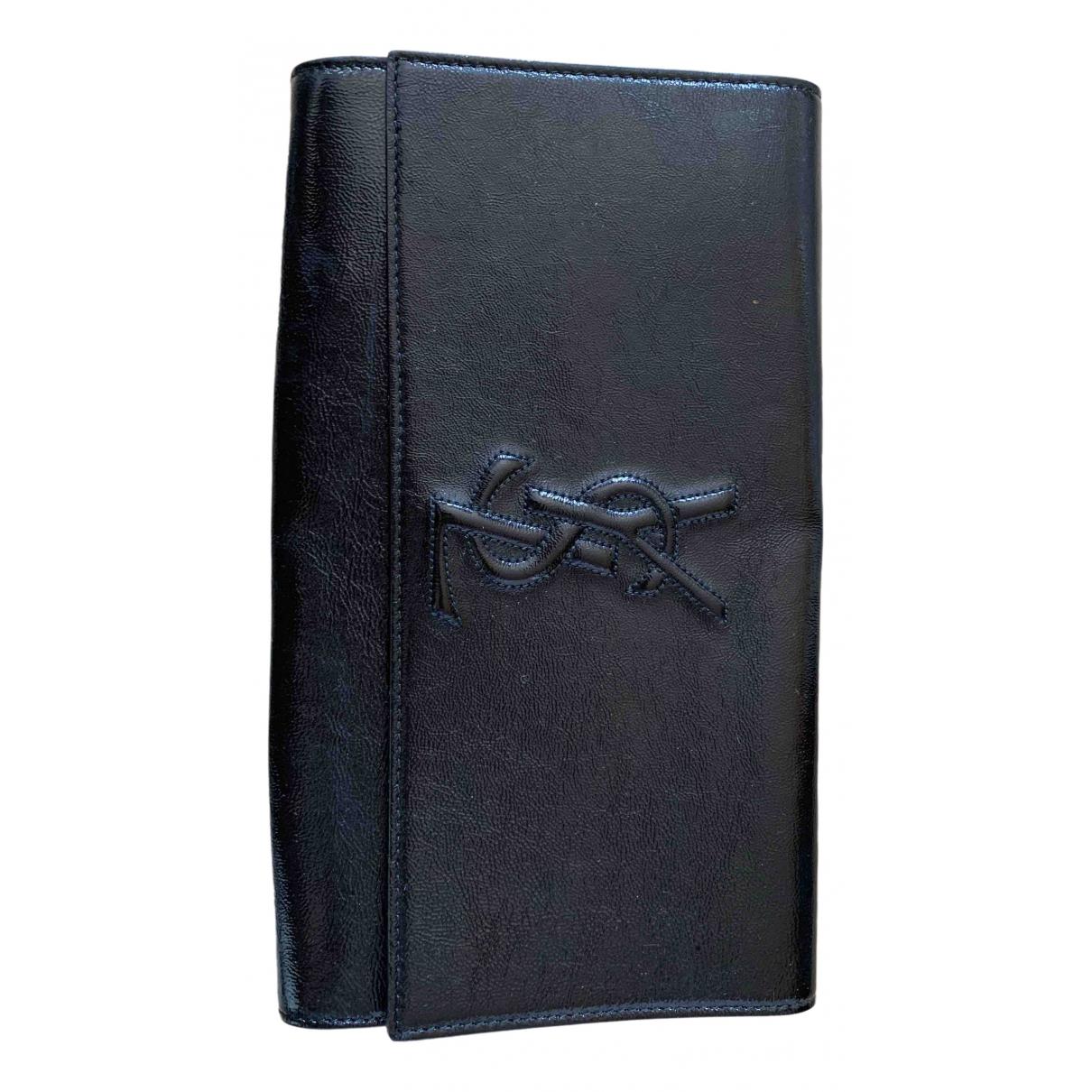 Yves Saint Laurent - Pochette Belle de Jour pour femme en cuir verni - noir