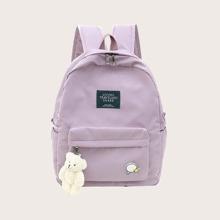 Rucksack mit Taschen vorn und Buchstaben Flicken