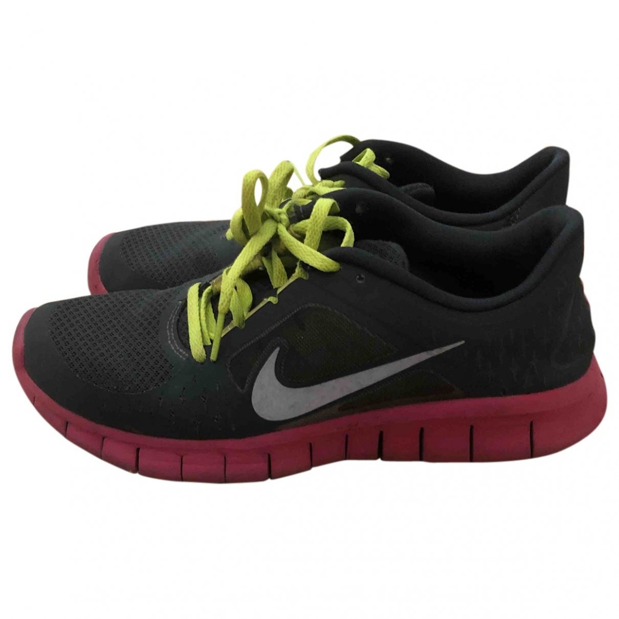 Nike - Baskets Free Run pour femme en toile - gris