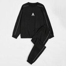 Sudadera con estampado de letra ribete en contraste con pantalones deportivos