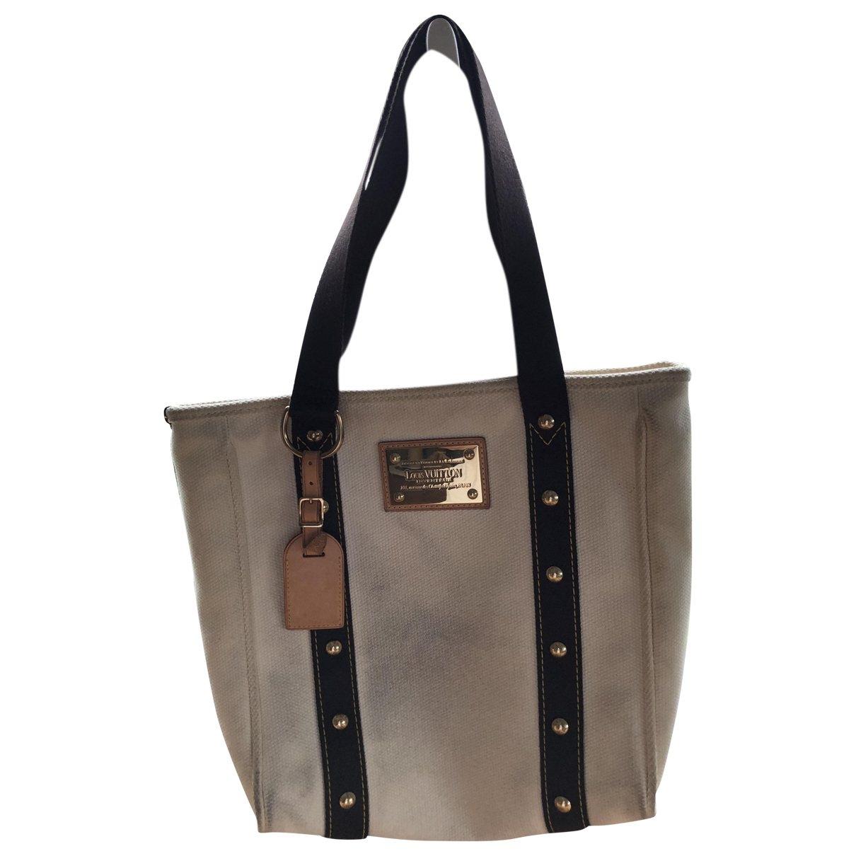 Louis Vuitton Antigua Handtasche in  Ecru Baumwolle