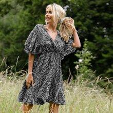 Kleid mit Gaensebluemchen Muster und V-Kragen vorn