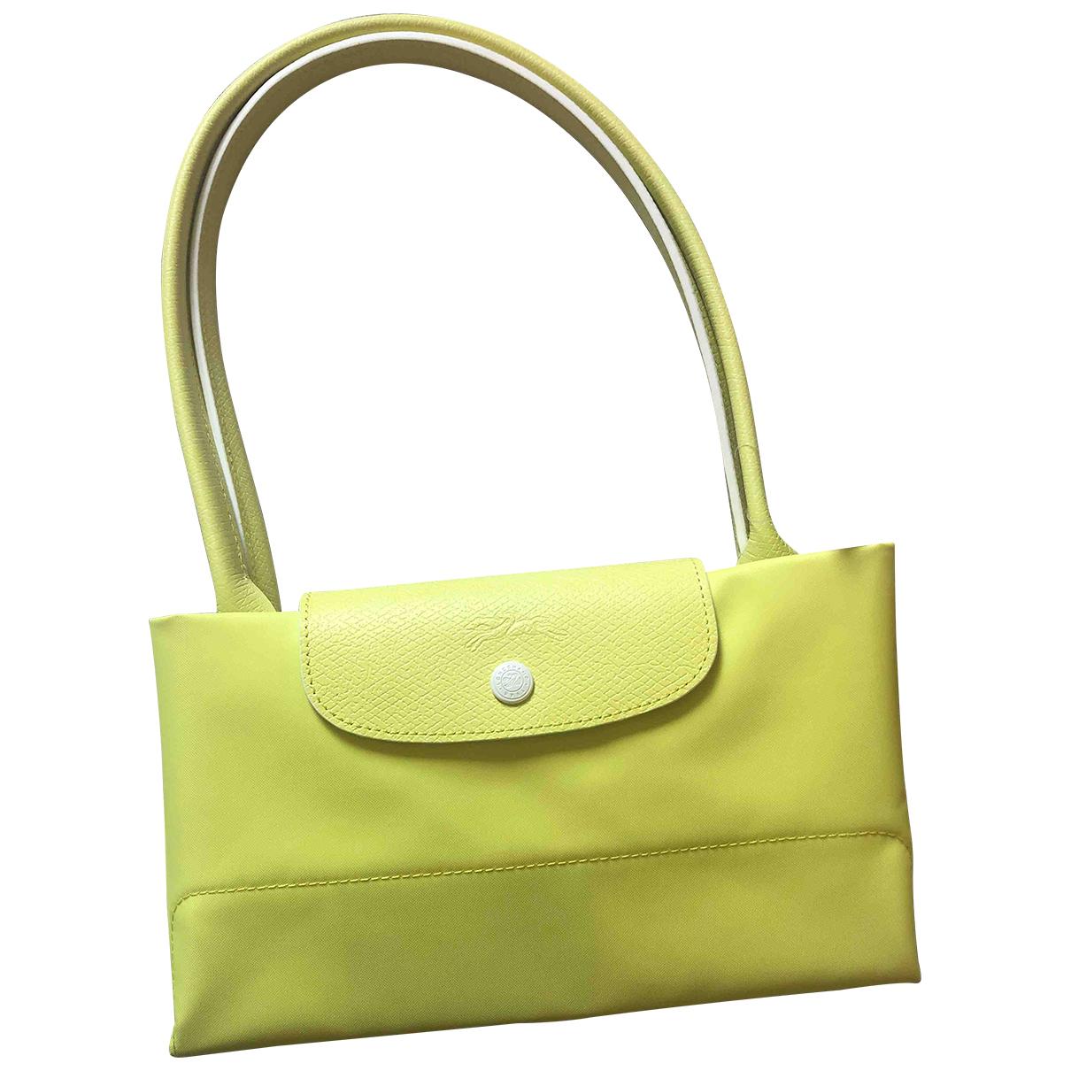 Longchamp Pliage  Yellow Metal handbag for Women \N