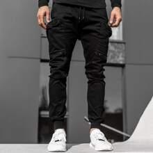 Pantalones deportivos de cintura con cordon con cremallera
