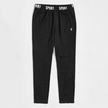 Men Letter Waistband Embroidery Detail Pants